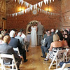 A wedding ceremony at Dairy Barns - the advantage of two photographers is that you can get photos from both the back and front of the venue during the ceremony