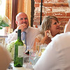 A bride and groom listening to her fathers speech at Dairy Barns