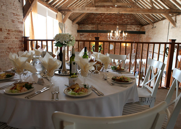 The balcony at Dairy Barns set up for a wedding breakfast