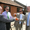 Groom getting a swift drink before his wedding at Dairy Barns