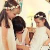 Tweaks to the flowergirl's dresses before the ceremony at Dairy Barns
