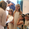 Flowergirls being given their presents and instrustions by a bride at Dairy Barns