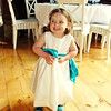 A cheeky little flowergirl in her colour co-ordinated wellies at a wedding at Dairy Barns