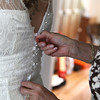 A bride being done up into her dress