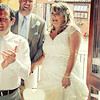 A bride and groom being welcomed in to their wedding breakfast at Dairy Barns by their guests