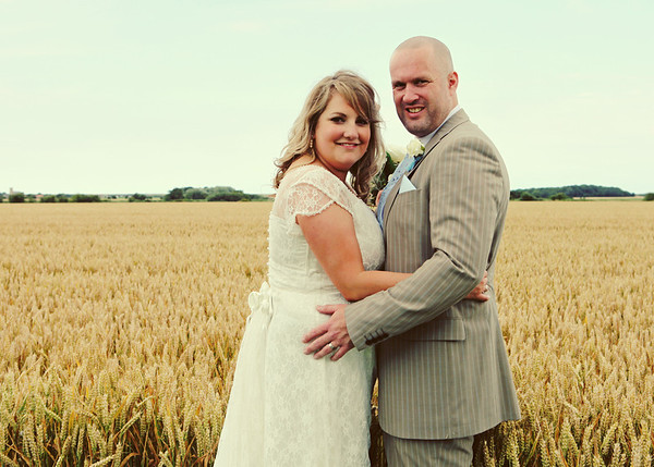 A bride and groom in the fields at Dairy Barns