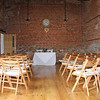 The room set up for a wedding ceremony at Dairy Barns