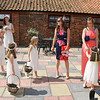 Flowergirls waiting in the Courtyard at Dairy Barns for the bride to be ready
