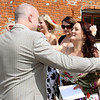 The groom arriving for his wedding at Dairy Barns and greeting guests