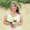 A bride down on Sea Palling beach before going back to Dairy Barns for their wedding reception