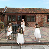 Flowergirls playing in the Courtyard at Dairy Barns before a wedding
