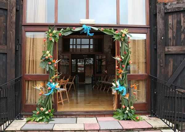 A gorgeous exotic floral archway to lead you in to a Dairy Barns Wedding