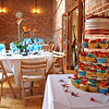A wedding cake and the room set up for a wedding breakfast at Dairy Barns