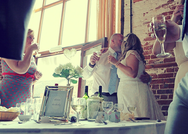 A happy bride and groom during the speeches at Dairy Barns