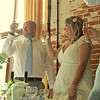 A bride and groom toasting the bestman after his speech at Dairy Barns