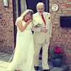 A bride walking over to her wedding ceremony at Dairy Barns with her dad