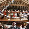Guests on the balcony at a wedding at Dairy Barns watching the speeches