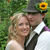 A very happy couple in Elms Barn gardens on their wedding day
