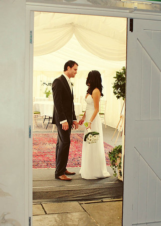 A bride and groom taking a moment out at Elms Barn before coming in for their wedding breakfast