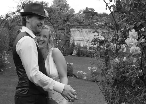 Pracitising their first dance in the gardens at Elms Barn