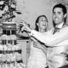 Cutting the cake at an Elms Barn Wedding