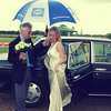 A bride arriving in the rain at Elms Barn