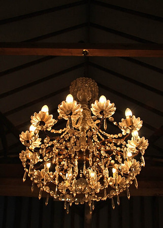 One of the chandeliers in the Main Barn at Elms Barn in the evening