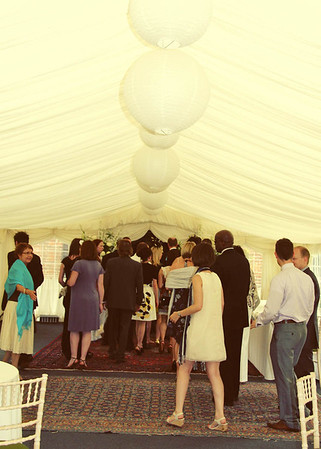 Guests going through into the ceremony room through the marquee