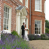 Outside the main house at Elms Barn at a happy wedding