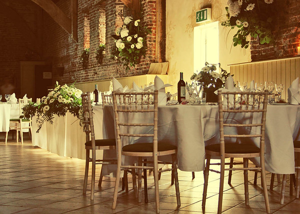 Elms Barn Wedding Reception set up with the top table down the side