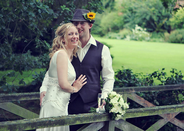 A gorgeous happy couple on the bridge at Elms Barn