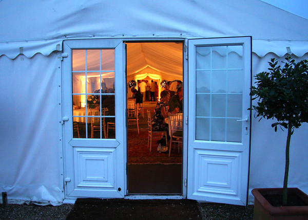 Into the evening reception at Elms Barn through the marquee