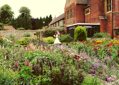 A bride and groom at their wedding in the Kitchen Garden at Haughley Park Barn