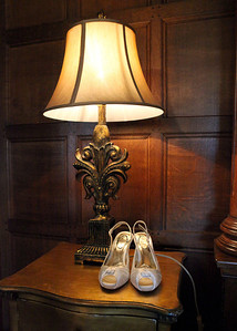 A brides shoes in Hengrave Hall on a wedding day