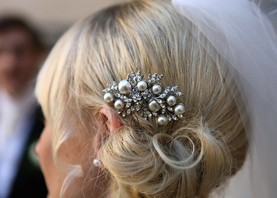 A brides vintage hair piece at a wedding at Hengrave Hall
