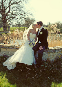 A bride and groom in front of the reed beds at their spring wedding at Hengrave Hall