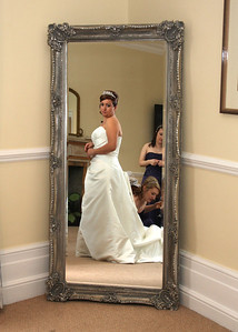 A bride getting ready at Hintlesham Hall for her winter wedding ceremony