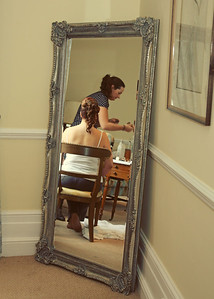 A bride getting ready at Hintlesham Hall for her wedding