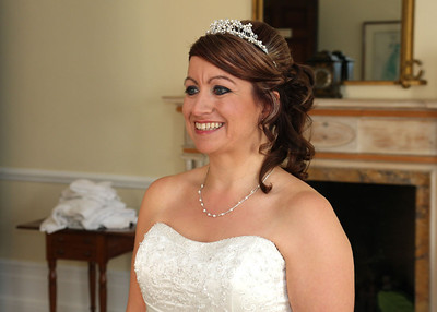 A bride before her winter wedding ceremony at Hintlesham Hall