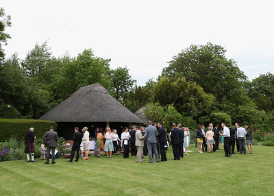 Guests enjoying themselves at a summer wedding reception at Otley Hall