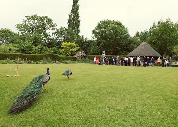Guests enjoying themselves at a summer wedding reception at Otley Hall