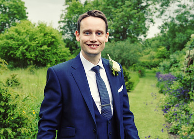 A happy groom on his wedding day at Otley Hall