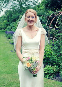 A happy bride on her wedding day at Otley Hall