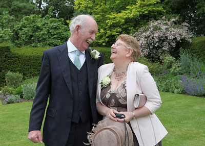 Parents of the bride enjoying themselves at a wedding reception at Otley Hall