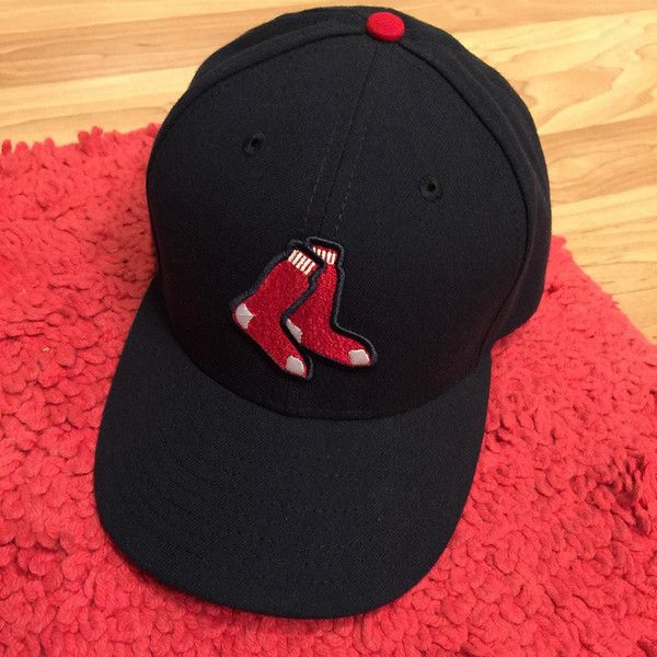 """Ever since we started talking about a day trip to Boston, Logan declared he wanted a Red Sox cap. Once he got there, he decided he liked the stockings logo better than the official """"B""""."""