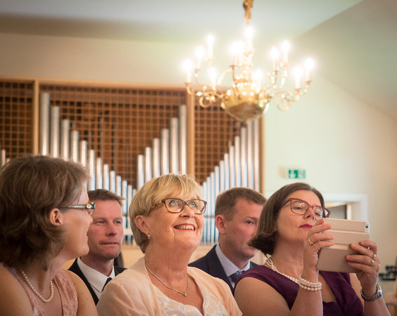 excited for the wedding, that is about to unfold - wedding guests at a norwegian wedding in Berlin