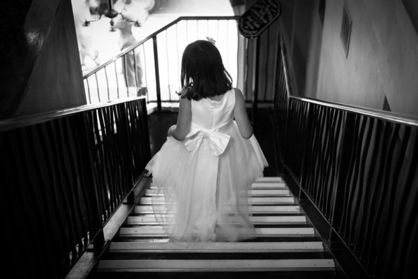 Bridesmaid walking down the stairs, London wedding