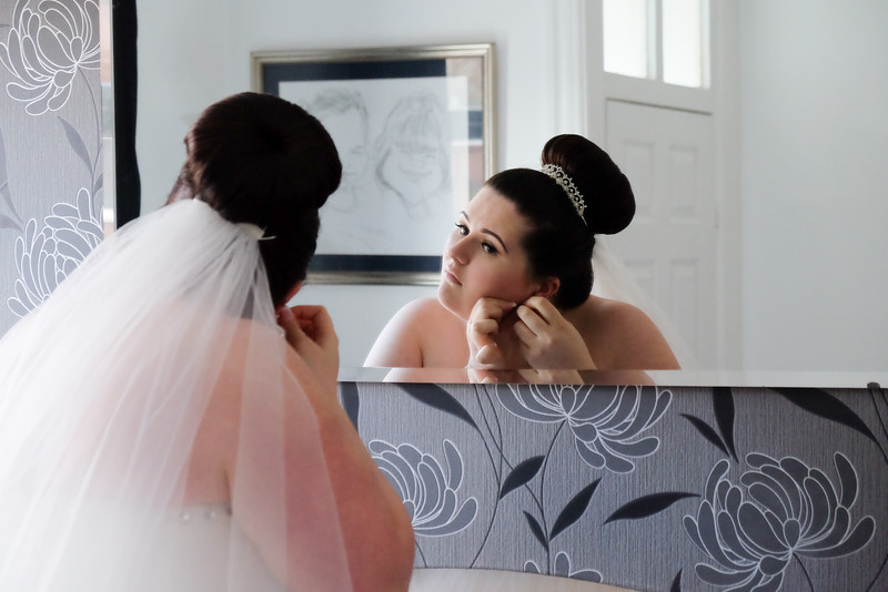 Bride looking mirror
