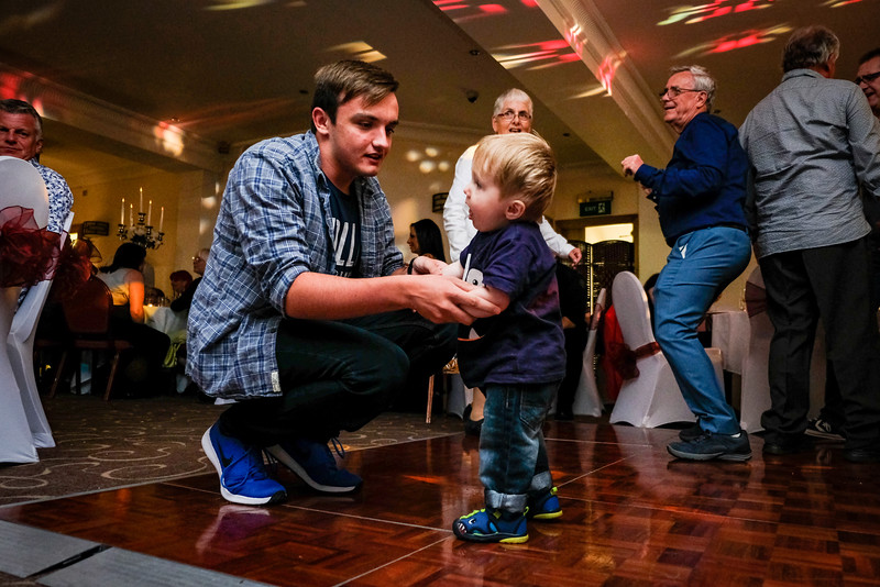 Young Lad Dancing with his Dad