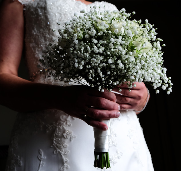 Bride holds wedding bouquet